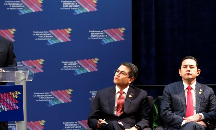 Secretary of State Rex Tillerson, left, speaks during a conference on Prosperity and Security in Central America, Thursday, June 15, 2017, in Miami. Also on stage are President of Honduras Juan Orlando Hernandez, left, President of Guatemala Jimmy Morales, center, and the Vice President of El Salvador Salvador Oscar Ortiz, right. (AP Photo/Wilfredo Lee, Pool)